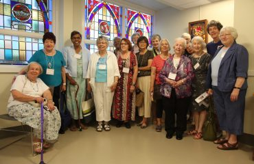 Photo of former staff, nursing alumni, and community members to celebrate the 650 Church Street re-dedication ceremony.
